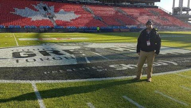 Robert Heggie standing on the BMO Field, Freshly Painted for the Grey Cup